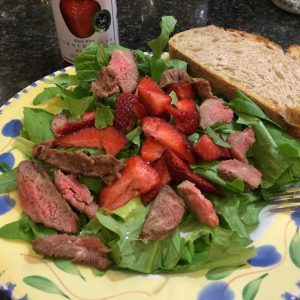 Spinach salad with leftover steak and strawberries