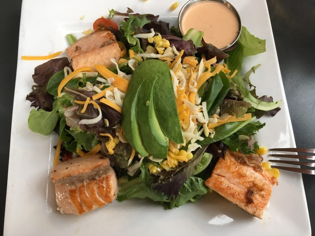 Salad with salmon, greens, avocado and cheese-- a great main dish salad.