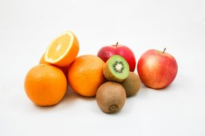 Apples, oranges and kiwis. Antioxidant-rich fruits that may affect allergy symptoms.