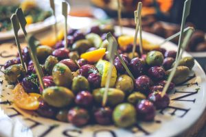 Black and green olives with lemon