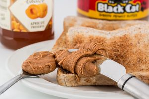 Peanut butter on toast with jam.