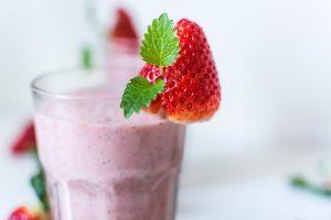 Strawberry smoothie with fresh strawberry garnish.