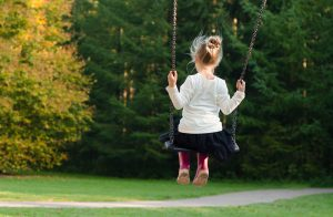 Girl in swing. Seasonal allergies can be a pain--check out diet info here.