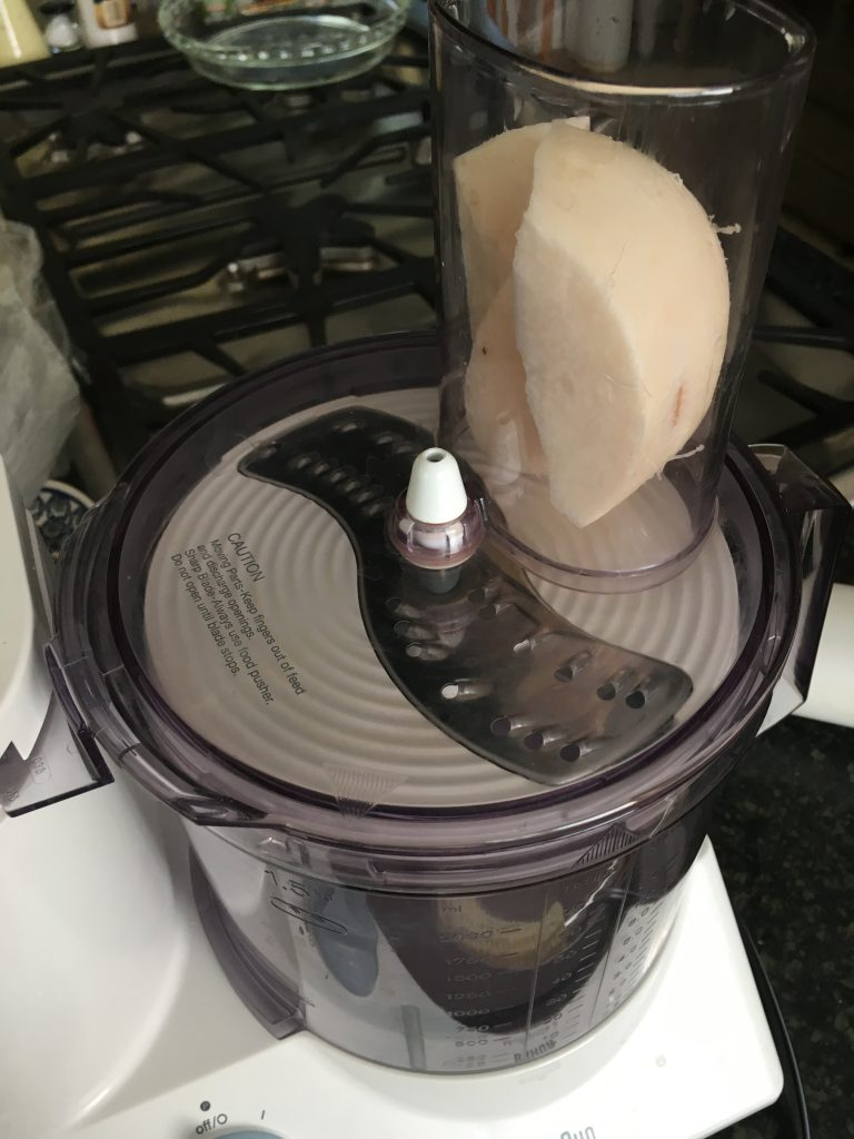 It's easy to grate jicama in the food processor. Check out this recipe from www.eatrightmama.com.