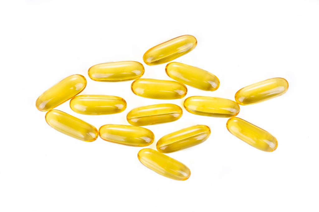 Fish Oil capsules in shape of fish.